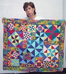 Diane Hill with her Peace & Plenty to Live & Grow Quilt